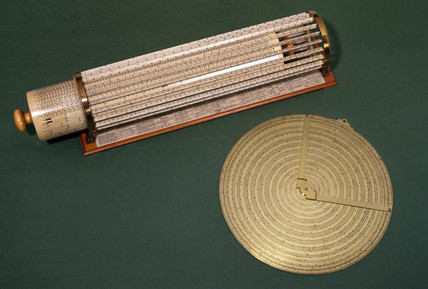 Two slide rules, 1663 and 1881.