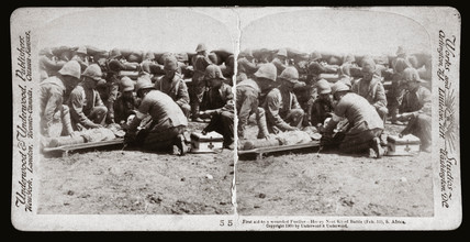 First aid to a wounded Fusilier - Honey Nest Kloof Battle, South Africa', 1900.