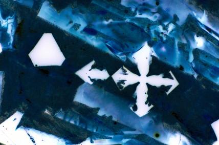 Iron oxide slag. Light micrograph in darkgo