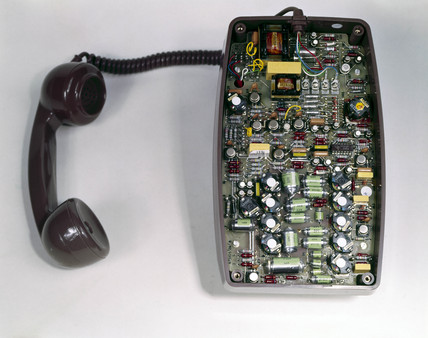 Sectioned view of telephone with handset, c 1960.