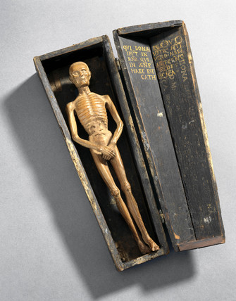 Figure of a man in a coffin, Italy, 16th century.