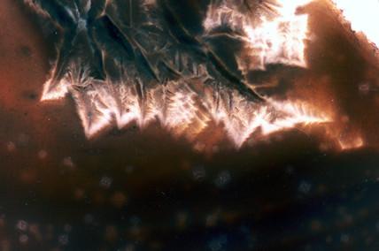 Slag. Light micrograph in darkground.
