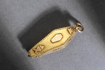 Skeleton in coffin pendant.