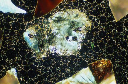 MMC ceramic particles in a steel matrix. Li
