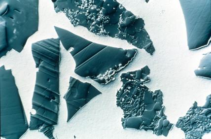 Ceramic particals in steel matrix. Light