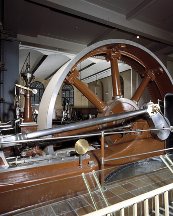 Mill engine wheel in the East Hall, Science Museum, London, c 1985.