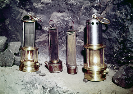 Two 'bonneted' clanny lamps and two clanny lamps, c 1880s.