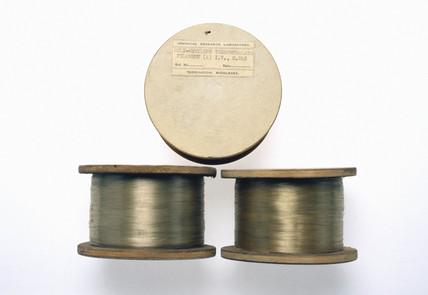 Three spools of polyethylene terephthalate filaments, 1943-1944.