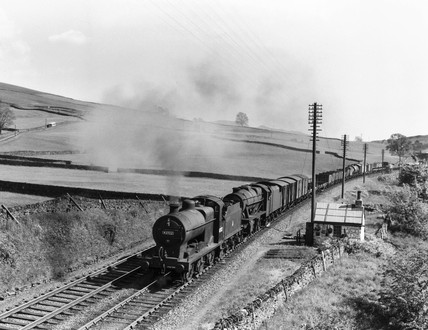 Two steam locomotives double-heading a freight train, c 1958.