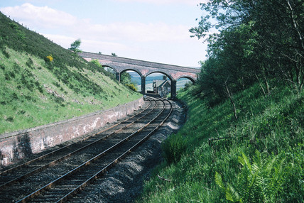 Railway line, with station in the distance.