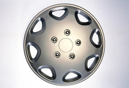 Motor car wheel hub cover, 1990s.