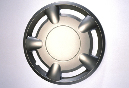 Motor car wheel hub cover, 1990s.