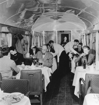 Taking lunch in a British Railways First Clas dining car, March 1951.