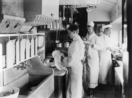 Chef with his staff at work in GER kitchen, Norfolk Coast Expres, 1907.