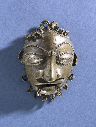 Pendant in the form of a human mask, Nigerian, 1801-1920.