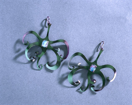 Opal and green/purple tantalum earrings, 1976.