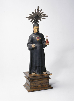 Pottery figure of St John of God, c 1700.