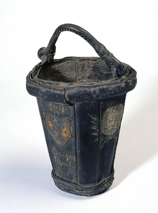 Black leather fire bucket, probably 18th century.