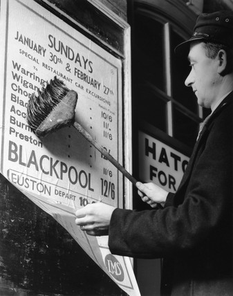 Posting a notice of forthcoming excursions, 1937.