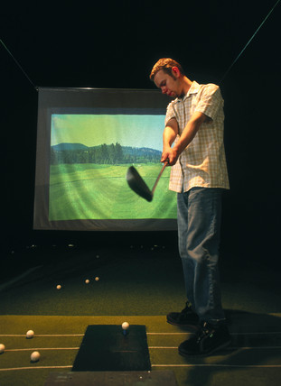 Man playing the Virtual Reality Golf exhibit, August 1997.