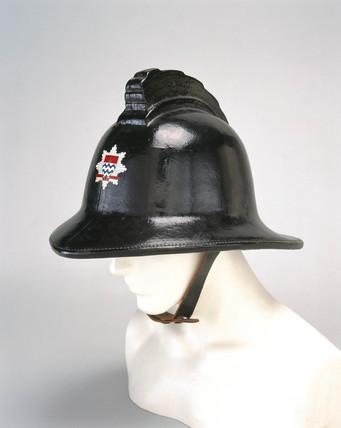 Black firefighting helmet, 1966.