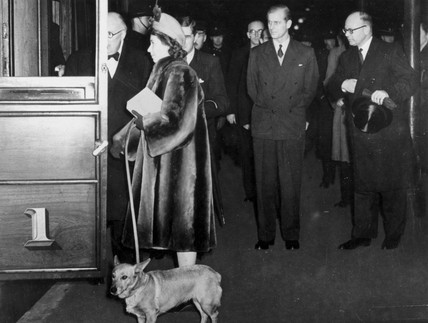 Princes Elizabeth, together with her pet corgi.