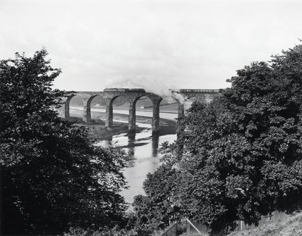 LNER clas A4 steam locomotive crosing Royal Border Bridge, c 1938.