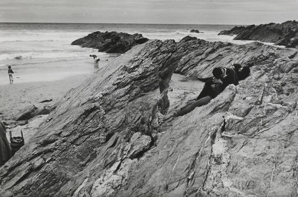 Two young couples canoodling on rocks, 1967.