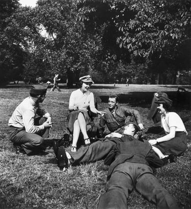'Welfare girls' and servicemen in a park, World War Two, 1942.