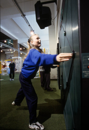 Visitors in the Science of Sport Gallery, Science Museum, London, 1997.