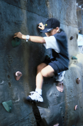 Child climbing on the Rock Face Challenge, 1997.