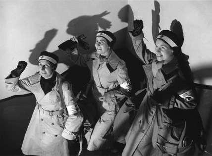 Red Cros nurses giving communist salute, January 1937.