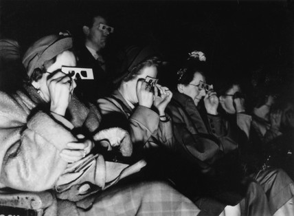 Audience watching a 3D film, c 1940s.