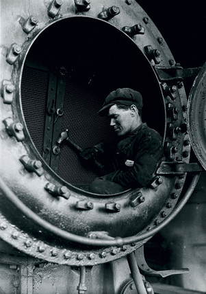 Man in a firebox, c 1925.