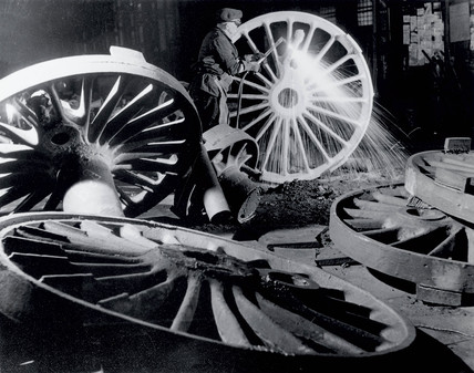 Burning off the 'runners' from driving wheel castings,1950.