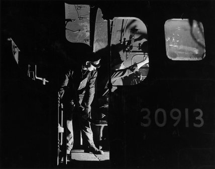 Driver and fireman on the footplate of steam locomotive, c 1957.