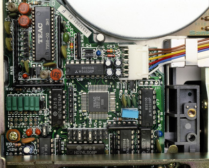 Interior of a computer floppy disk unit, c 1980s.