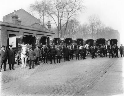 Horse-drawn delivery vans, Euston station, London, c 1926.