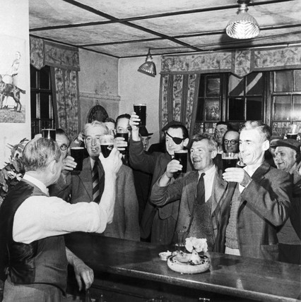 Men drinking beer in a pub, May 1945.
