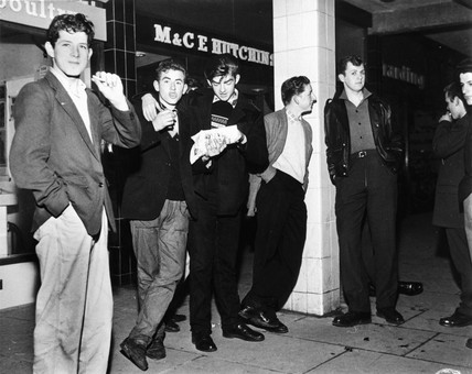 Youths outside chip shop, Durham, October 1959.
