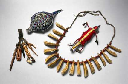 Amulets, necklace and bottom part of a needle case, USA or Canada and Inuit.