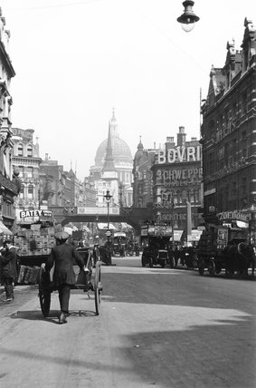 London street with St Paul's Cathedral in the distance, c 1920s.