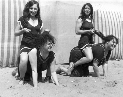 Horseplay on the beach, c 1920s.