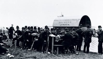 Policemen eating sandwiches at a country festival, c 1910.