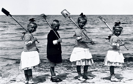 Four children at the seaside, c 1910s.