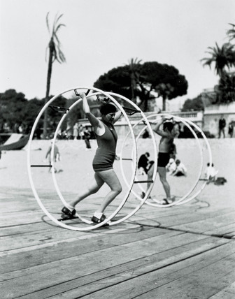 Couple using exercise wheels on a Florida beach, United States, c 1935.
