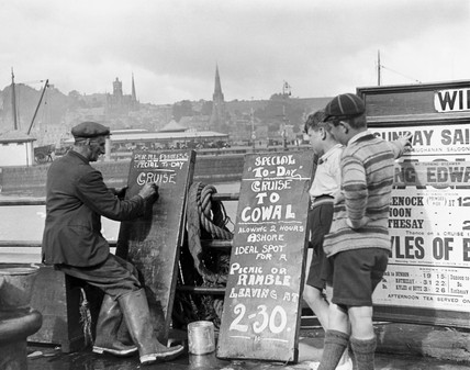 Man writing a sign, western Scotland, c 1920s.