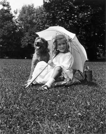 Little girl and dog, c 1930s.
