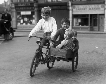 Boys riding on a bicycle with a 'home-made' sidecar, c 1930s.