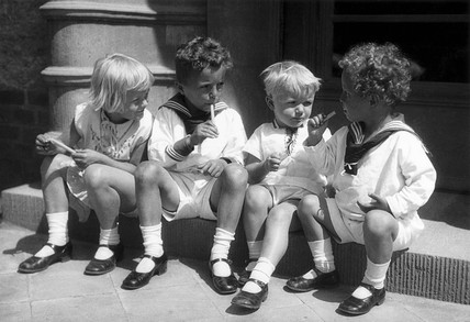 Children eating ice-lollies, c 1930s.